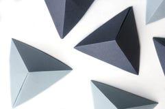 Origami 3 afmetingsvormen in zwart-wit kleuren stock afbeeldingen