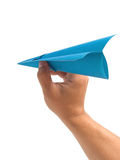 Origami airplane in hand stock photography