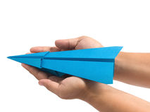 Origami airplane in hand Stock Photos