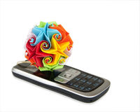 Origami attached to mobile phone Stock Photography