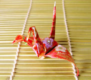 Origami on a bamboo floor. A Japanese paper figurine on a bamboo floor Royalty Free Stock Photography
