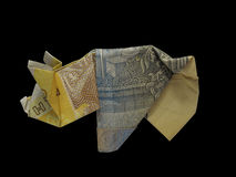 Origami bank-note pig isolated on black Royalty Free Stock Photo