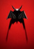 Origami bat on a red background Royalty Free Stock Photo