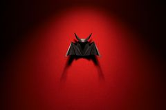 Origami bat on a red background. Black bat origami on a red background Stock Photo