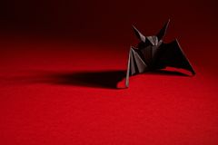Origami Bat On A Red Background Royalty Free Stock Images