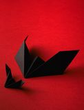 Origami bat on a red background Royalty Free Stock Image