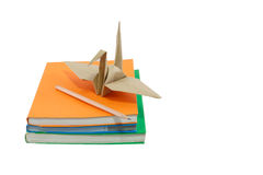 Origami Bird on books isolated and white background. Origami Bird on books isolated of white background royalty free stock photography