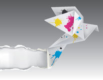 Origami bird with ink ripping paper Royalty Free Stock Photo