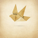Origami Bird  on paper background Stock Photos