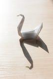 Origami bird on the table Stock Photo