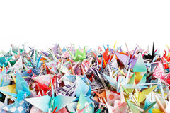 Origami birds. Close up of a pile of origami birds on a white background Stock Image