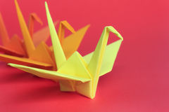 Origami Birds. Three paper birds on a red background, shallow depth of field Royalty Free Stock Images