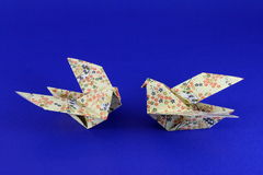 Pair of Paper Origami Doves. Paper folded origami birds doves or pigeons from flower paper royalty free stock image