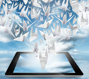 Origami Birds in flight on tablet pc Royalty Free Stock Image