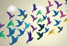 Origami Birds flying and fake clouds Royalty Free Stock Image