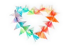 Origami birds heart. Colourful paper birds arranged in a heart shape on a white background stock photo