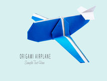 Origami blue airplane Royalty Free Stock Photos