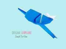 Origami blue airplane. Origami blue cartoon paper travel isolated airplane on a blue background Royalty Free Stock Photos