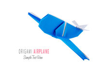 Origami blue airplane. Origami blue cartoon paper travel isolated airplane on a white background Royalty Free Stock Photos