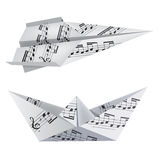 Origami boat and airplane with musical notes Stock Photo