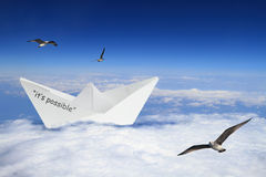 Origami boat floating in clouds Royalty Free Stock Photo