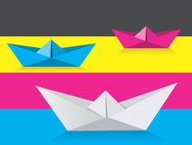 Origami boats on print colors background Stock Photos