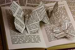 Origami butterflies coming out of a book Royalty Free Stock Photo