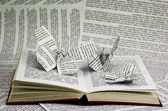 Origami butterflies coming out of a book Royalty Free Stock Photos