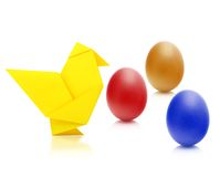 Origami chicken. From paper and easter eggs Royalty Free Stock Photo