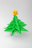 Origami - a Christmas tree. Origami - a Christmas green tree with star stock images