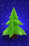 Origami christmas tree. On blue background Stock Images