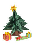 An origami Christmas tree. With a yellow star on its top and presents under it, isolated on a white background stock image