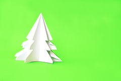 Origami Christmas tree paper on green background Royalty Free Stock Image