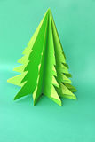 Origami Christmas tree paper on green background Stock Images