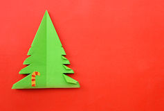 Origami Christmas tree paper on red background Stock Image