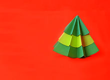 Origami Christmas tree paper on red background Stock Photos