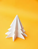 Origami Christmas tree paper on yellow background Royalty Free Stock Photo