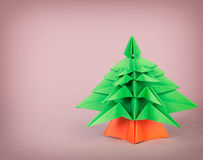 Origami christmas tree on pink background Stock Photo