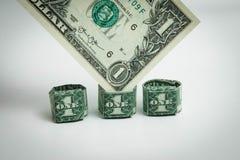 Origami coeur et billet d'un dollar d'anneau un dollar Photo libre de droits