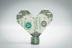 Origami coeur et billet d'un dollar d'anneau un dollar Photo stock