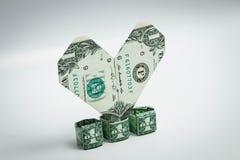Origami coeur et billet d'un dollar d'anneau un dollar Images libres de droits