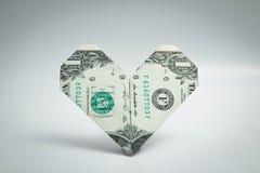 Origami coeur et billet d'un dollar d'anneau un dollar Image libre de droits