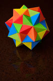 Origami Color Ball. Multicolored, 60-sided, modular origami ball.  More specifically, and from a mathematical point of view, it is a lesser stellated icosahedron Royalty Free Stock Images