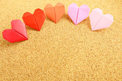 Origami colorful heart on corkboard Stock Photos
