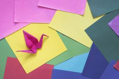 Origami on a colorful paper. Origami background. Bird shape origami Stock Photography