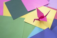 Origami on a colorful paper. Origami background. Bird shape origami Stock Photos