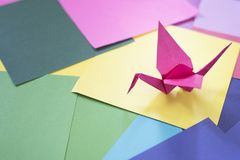 Origami on a colorful paper. Origami background. Bird shape origami Stock Image