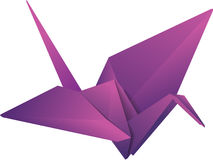 Origami crane. Purple isolated paper origami crane Royalty Free Stock Photo