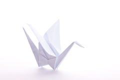 Origami Crane. White paper-folded Origami crane, on white royalty free stock image