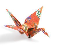 Origami Crane. Folded with a red floral pattern paper royalty free stock photography